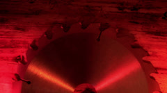 A blade saw under a red-lighted room Stock Footage