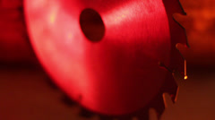 Front view of a saw blade under red-lighted room Stock Footage