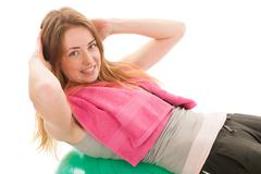 sport woman with ball training the abs - stock photo