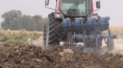 Iranian farmer plows a dry piece of land with a tractor Stock Footage
