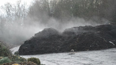 Fuming compost heap - stock footage