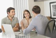 Stock Photo of Customers talking to advisor in office