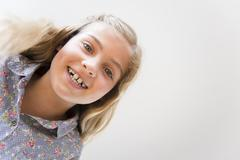 Stock Photo of Portrait of smiling blonde girl (8-9)