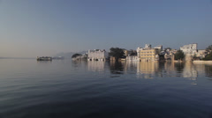 Beautiful Udaipur Cityscape- white buildings + lake with reflections at sunrise Stock Footage