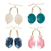 pearlescent earrings different - stock photo