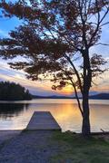 Adirondacks Dock Sunset - stock photo