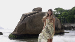Stock footage Rio De Janeiro beach, attractive model in flowing dress Stock Footage