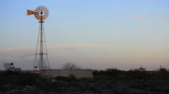 Old Fashioned Wind Mill Pumping Water - Texas 3 Stock Footage