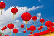 Stock Photo of red chinese paper lanterns against a blue sky