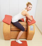 girl in sportwear on relax massage equipment healthy spa salon - stock photo