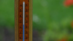 Fast rising temperature on wooden outdoor thermometer scale Stock Footage