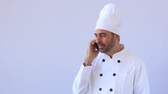 Chef holding mobile phone Stock Footage