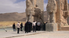 Persepolis, Iranian tourists enter the gates of ancient city Stock Footage