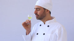Chef drinking limoncello Stock Footage