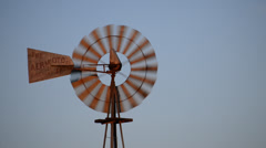 Old Fashioned Wind Mill Pumping Water - Texas 2 Stock Footage