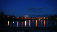 Evening lights of Petrozavodsk on river shore Stock Footage