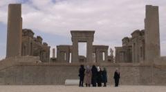 Iranian tourists look at Persepolis remains, tourism Iran, group, women Stock Footage