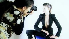 Stock Video Footage of Female model in studio photo shoot