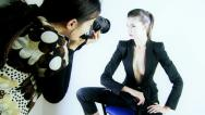 Female model in studio photo shoot Stock Footage