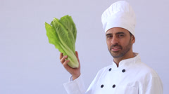 Chef presents and playing with lettuce - stock footage