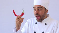 Chef with red hot chili pepper Stock Footage