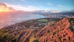 4k, UHD, Golden sunset through Honolulu cityscape, from Diamond Head, Oahu, Hawa Stock Footage