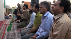 Iran, men attend prayer inside mosque - stock footage