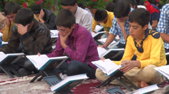 Young men study the Quran in Iran, teaching lessons books Islam Stock Footage