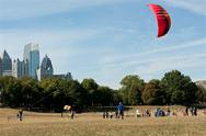 Stock Photo of woman gets kite airborne at autumn festival
