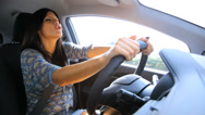 Stock Video Footage of Woman seducing smiling and driving happy