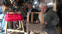 Iran, men are rolling up wool on the Tabriz bazaar Stock Footage