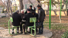 Iran, senior men are playing chess in a park Stock Footage