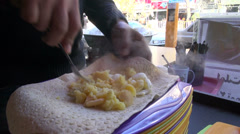 Restaurant in Iran, mashing potatoes, eggs, to make a sandwich Stock Footage