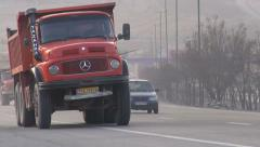 Heavily polluting trucks drive over highway near Tabriz in Iran Stock Footage