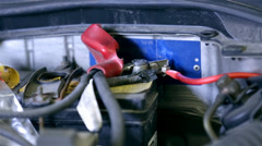 Electric wiring on car accumulator for audio amplifier - stock footage