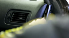 Close up of Removing side mask of car armature - stock footage