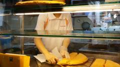 Food vendor preparing and packing Chinese pancakes SINGAPORE CHINESE PANCAKE--1 Stock Footage