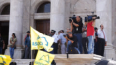 Off-focus police barricade at protest state capitol building 6 Stock Footage