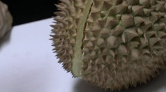 Close-up view on opening up a semi-opened durian. (OPEN A DURIAN--5) Stock Footage