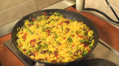 Mexican Rice Cooking In The Frying Pan And Adding Salt Stock Footage