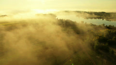 Flying over fields and rivers in the fog. Altai. Siberia - stock footage