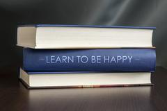 Learn to be happy. book concept. Stock Illustration