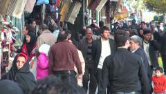 Iran, busy, crowded shopping street, women wearing chadors, men, people Stock Footage