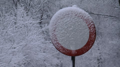 Road sign in snowstorm - close up Stock Footage