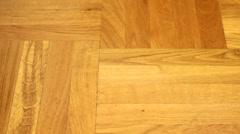 Vacuuming parquet floor Stock Footage