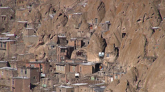 'Kandovan' village in Iran, homes built into curious rock formations Stock Footage