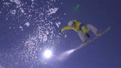 SLOW MOTION: Snowboarder jumps the kicker Stock Footage