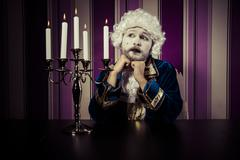 Stock Photo of romance, man dressed in rococo style, concept of wealth and poverty.