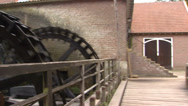 Stock Video Footage of Historical saw mill with 3 water wheels in operation + pan