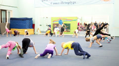 Small preschool children doing exercises in sport and health center - stock footage